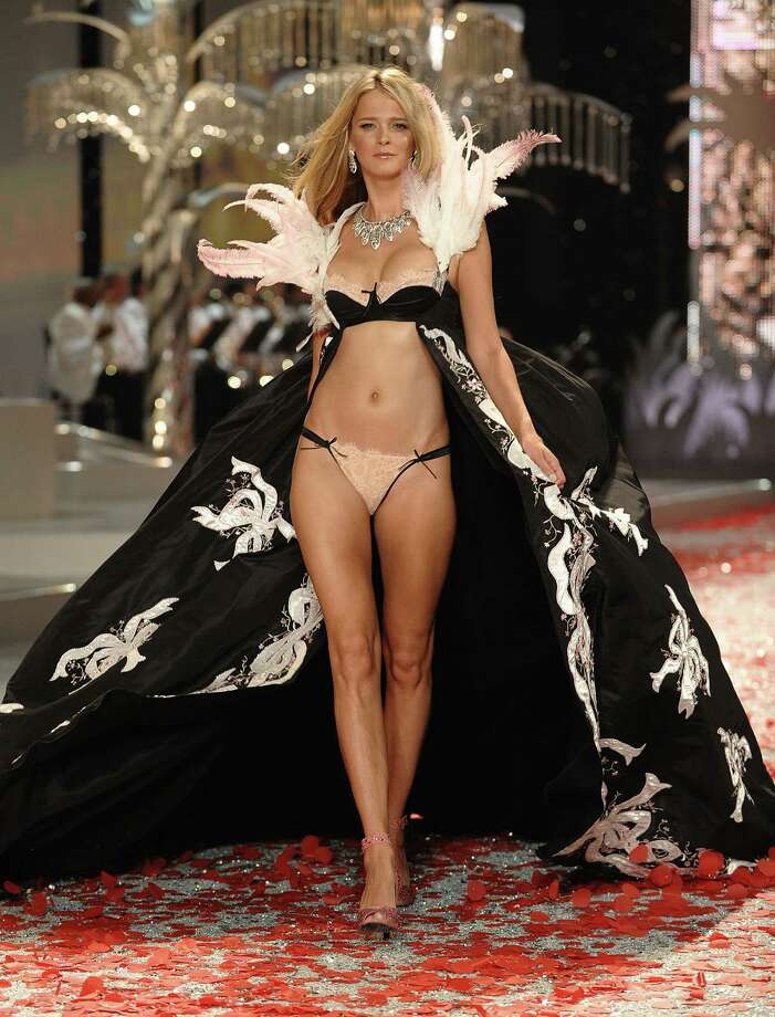 2008: Carman Kass walks the runaway at the 2008 Victoria's Secret Fashion Show at the Fontainebleau Hotel on Nov. 15, 2008 in Miami Beach, Florida. (Photo by Dimitrios Kambouris/WireImage) Photo: Dimitrios Kambouris, Getty Images / 2008 WireImage
