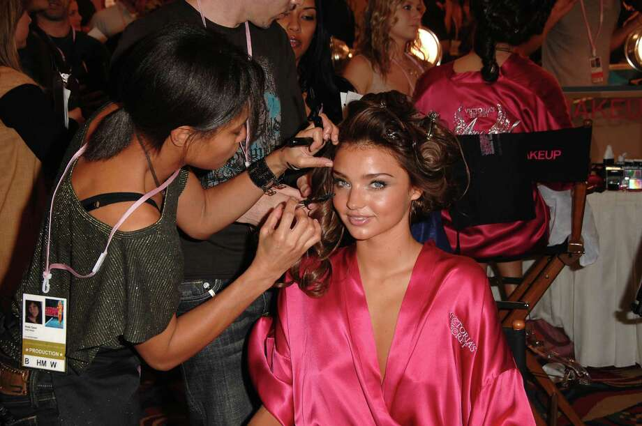 2007: Adriana Lima getting hair and makeup done before the 12th Annual Victoria's Secret Fashion Show at The Kodak Theatre on November 15, 2007 in Hollywood, Calif.  (Photo by Steve Granitz/WireImage) Photo: Steve Granitz, Getty Images / 2007 Steve Granitz