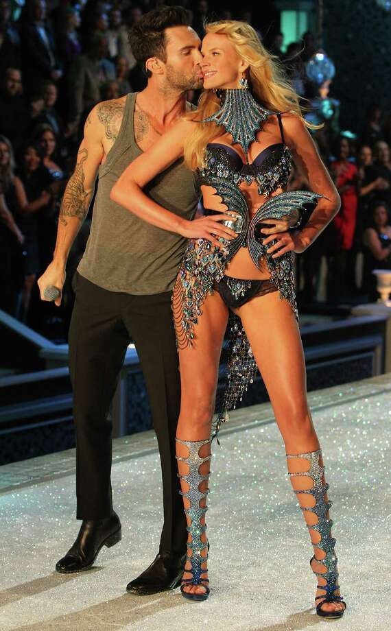 2011: Adam Levine of Maroon 5 with Model Anne V as she walks the runway during the 2011 Victoria's Secret Fashion Show at the Lexington Avenue Armory on November 9, 2011 in New York City.  (Photo by Kevin Kane/FilmMagic) Photo: Kevin Kane, Getty Images / 2011 Kevin Kane