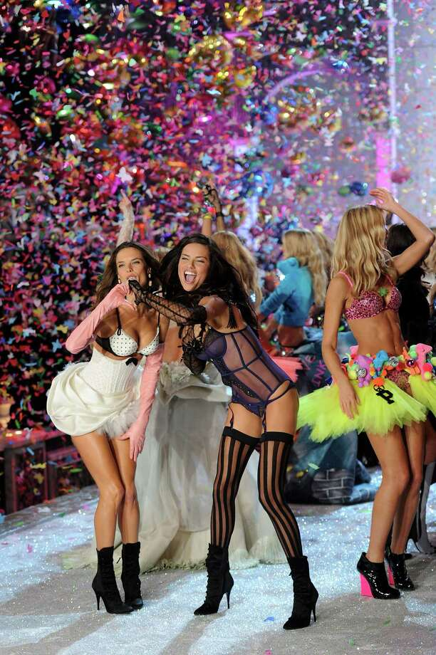 2011: Alessandra Ambrosio (L) and Adriana Lima walk the runway during the 2011 Victoria's Secret Fashion Show at the Lexington Avenue Armory on November 9, 2011 in New York City. Photo: Jamie McCarthy, Getty Images / 2011 Getty Images