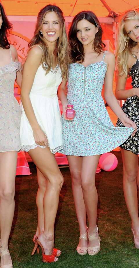 "2011: Supermodels (L-R) Alessandra Ambrosio and Miranda Kerr pose at the Victoria's Secret 6th Annual ""What Is Sexy? List: Bombshell Summer Edition"" Reveal at Victoria's Secret at The Grove on May 12, 2011 in Los Angeles, California.  (Photo by Jon Kopaloff/FilmMagic) Photo: Getty Images"