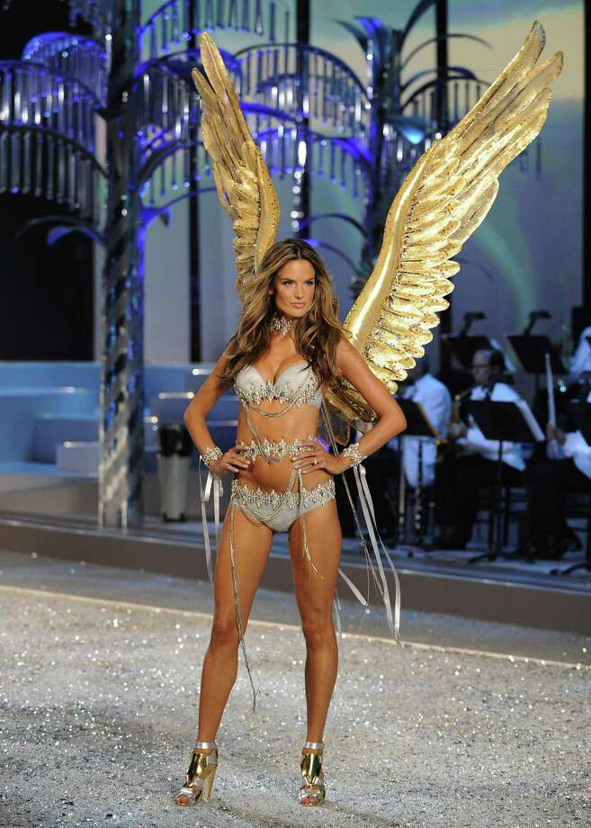 2008: Alessandra Ambrosia presents a creation during the Victoria's Secret Fashion Show at the Fontainebleau Miami Beach  November 15, 2008. The 54-year-old Resort in Miami, once the playground of the Rat Pack, is reopening this weekend for the taping of the Victoria's Secret TV Fashion Show, to be aired December 3, 2008 on CBS. Photo: TIMOTHY A. CLARY, Getty Images / 2008 AFP