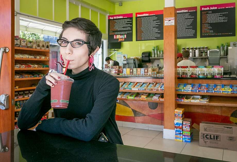 Raissa Palacios sips a pink-hued selection at Sidewalk Juice in San Francisco's Mission District. Photo: John Storey, Special To The Chronicle