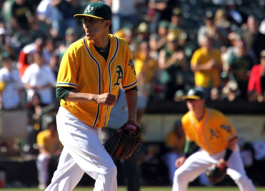 Oakland Athletics' Jesse Chavez pumps his fist after one of his six strikes outs in relief against the New York Yankees Thursday, June 13, 2013, in Oakland, Calif.
