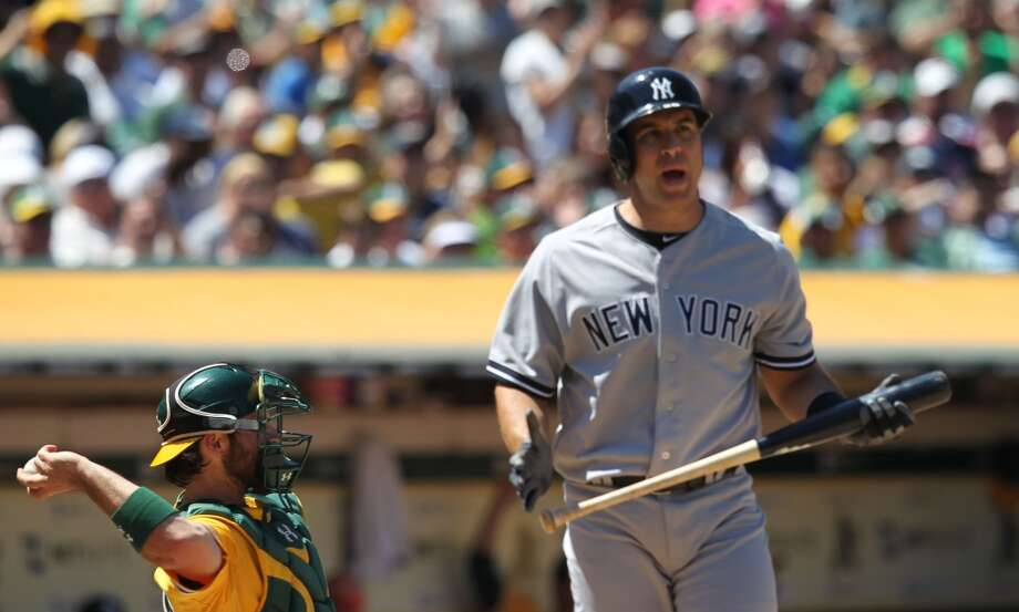 New York Yankees Mark Teixeira reacts after Oakland Athletics' pitcher Grant Balfour got Teixeira out on strikes in the 9th inning of their MLB  baseball game Thursday, June 13, 2013, in Oakland, Calif. Oakland won 3-2