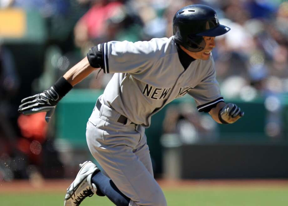 New York Yankees Ichiro Suzuki runs to first base on a base hit off Oakland Athletics' pitcher Ryan Cook in the 10th inning of their MLB  baseball game Thursday, June 13, 2013, in Oakland, Calif.