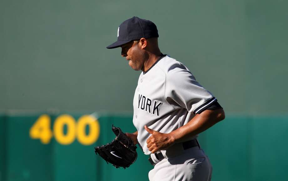 New York Yankees pitcher Mariano Rivera runs to the pitchers mound in the 18th inning of their MLB baseball game with the Oakland Athletics' Thursday, June 13, 2013, in Oakland, Calif. A's won 3-2
