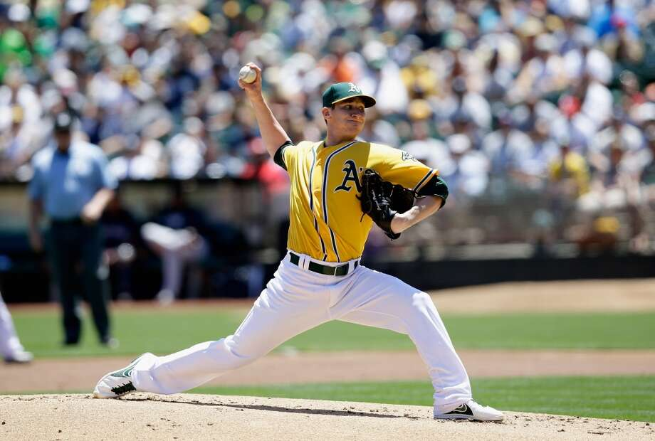 Jarrod Parker pitches against the New York Yankees at O.co Coliseum on June 13, 2013 in Oakland, California.