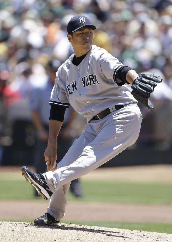 New York Yankees starting pitcher Hiroki Kuroda throws against the Oakland Athletics during the first inning of a baseball game Thursday, June 13, 2013 in Oakland, Calif.