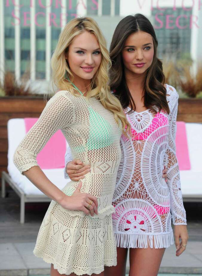2012: Victoria's Secret Angels Candice Swanepoel and Miranda Kerr launch the 2012 Swim Collection at the Thompson Hotel on March 29, 2012 in Beverly Hills, California. Photo: Alberto E. Rodriguez, Getty Images / 2012 Getty Images