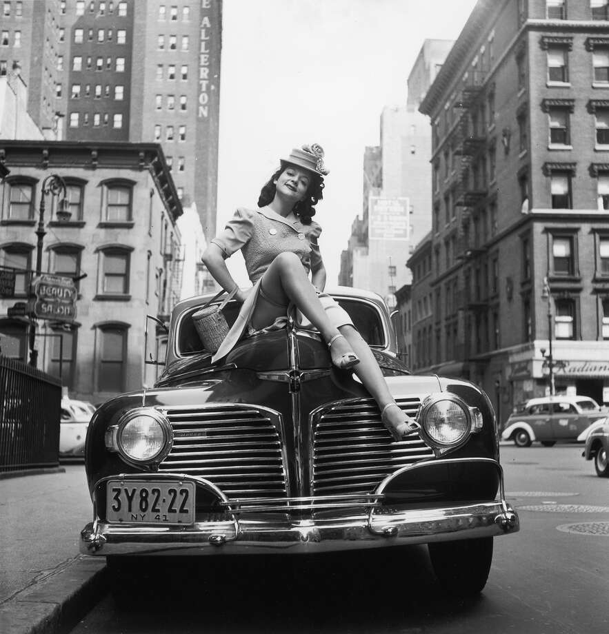 1941:  Portrait of American burlesque performer Rose La Rose posing on the hood of a Dodge car Photo: Hulton Archive, Getty Images / Archive Photos