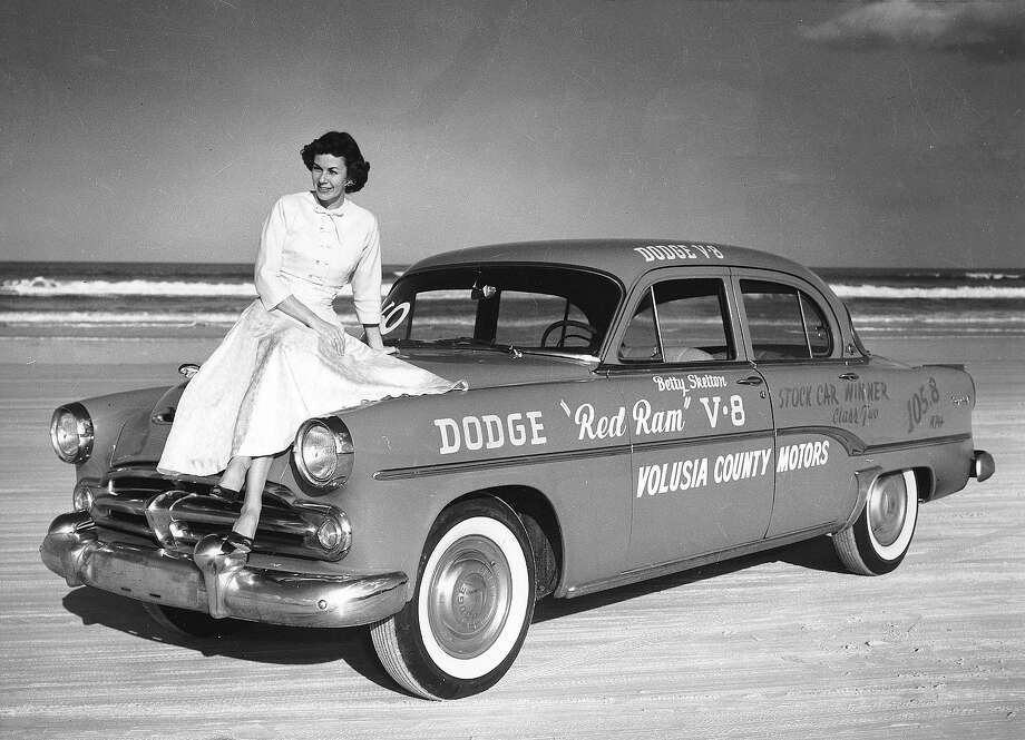 "1954:  Betty Skelton poses with the Dodge ""Red Ram V-8"" that she drove to a stock car speed record for women on Daytona Beach at 105.88 mph. Photo: RacingOne, ISC Archives Via Getty Images / 2010 RacingOne"