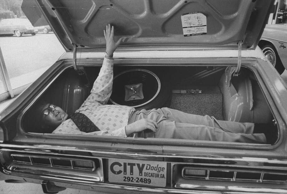 1971: Car salesman Leroy Carpenter demonstrating trunk capacity of new Dodge. Photo: Michael Mauney, Time & Life Pictures/Getty Image / Time Life Pictures