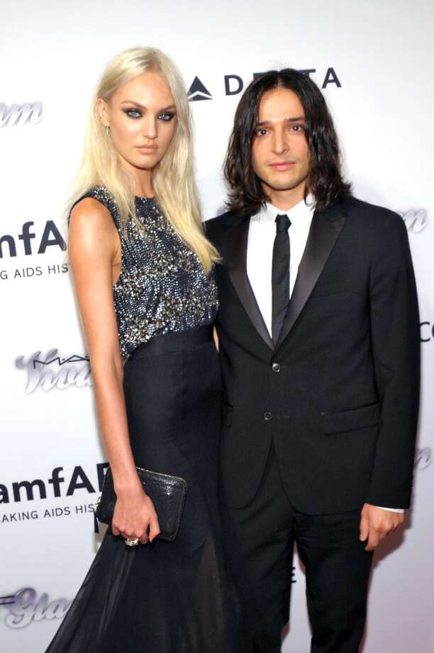 NEW YORK, NY - JUNE 13:  Model Candice Swanepoel (L) and designer Olivier Theyskens attends the 4th Annual amfAR Inspiration Gala New York at The Plaza Hotel on June 13, 2013 in New York City.  (Photo by Michael Loccisano/Getty Images)