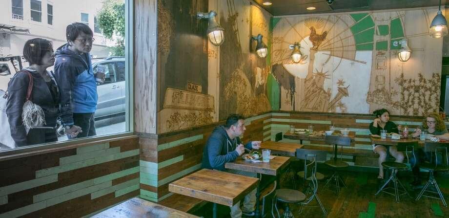 People enjoy lunch at Glaze Teriyaki Grill in San Francisco.