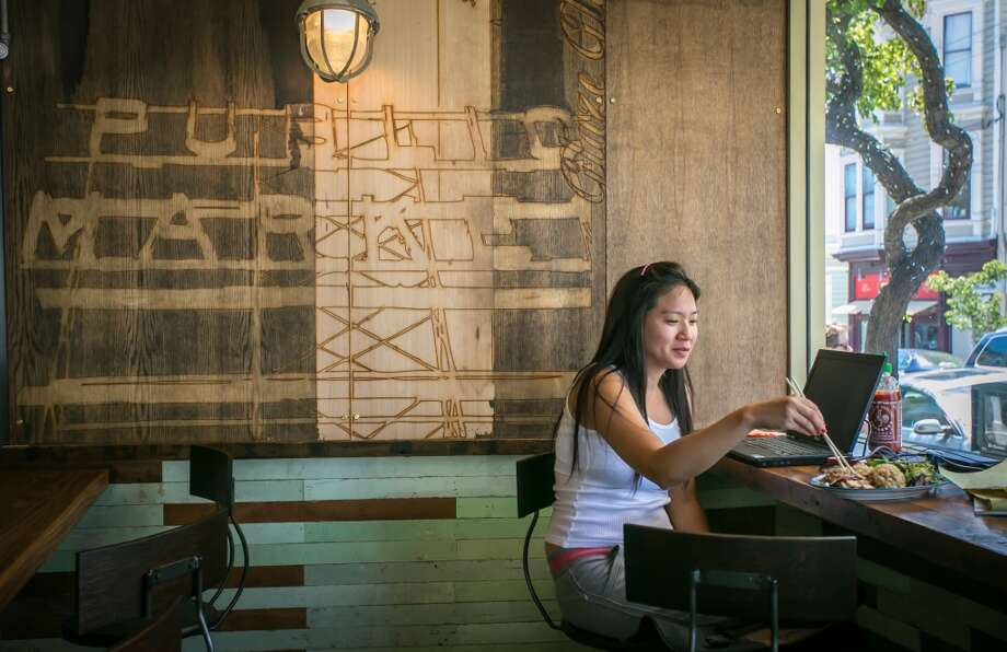 A woman enjoys lunch at Glaze Teriyaki Grill in San Francisco.