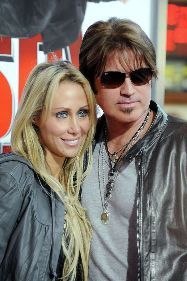 "FILE - In this Jan. 9, 2010 file photo, Billy Ray Cyrus, at right, and his wife Laeticia ""Tish"" Cyrus, arrive to the premiere of ""The Spy Next Door"" in Los Angeles. Court records show  Tish Cyrus filed for divorce on Thursday, June 13, 2013 in Los Angeles Superior Court. (AP Photo/Katy Winn, file) Photo: Katy Winn"