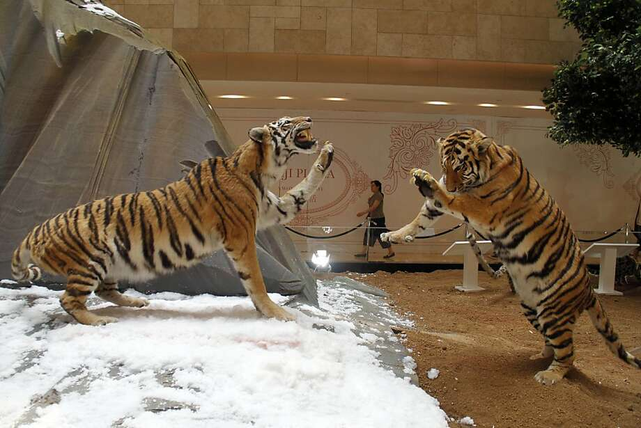 Velvet ropes are generally not recommendedfor tiger enclosures, but then again, most tiger enclosures don't have stuffed tigers. (Shopping mall in Nanjing.) Photo: Associated Press