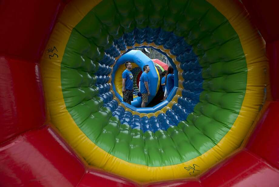 Here at Sauron Industries, we want you to be the best minion you can be:Workers take part in a company team-building exercise in Beijing. The giant eyeball is actually an inflatable tube. Photo: Ng Han Guan, Associated Press