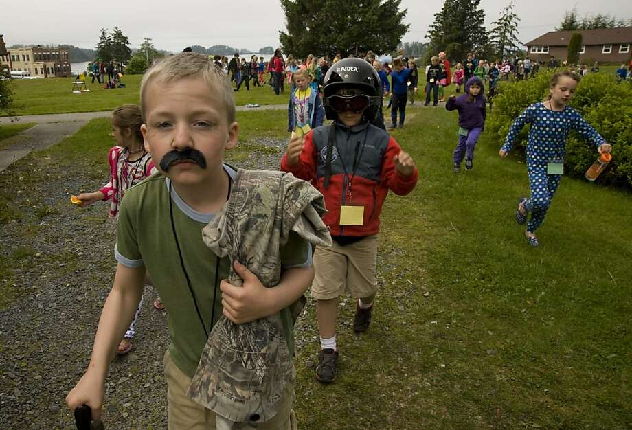 "Mature-looking for his age, 9-year-old Jason Young joins other students in the elementary school session of Sitka Fine Arts Camp's ""walk to class in costume"" in Sitka, Alaska. Photo: James Poulson, Associated Press"