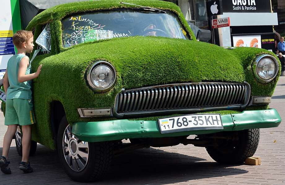 A rolling stone gathers no moss, but pretty much anything will grow on a rolling GAZ-21 Volga. The car was promoting green technology in Kiev. Photo: Sergei Supinsky, AFP/Getty Images