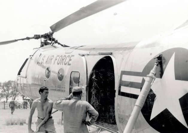 Crews are loading U.S.A. 7 helicopter with hay to carry to stranded cattle on July 20.