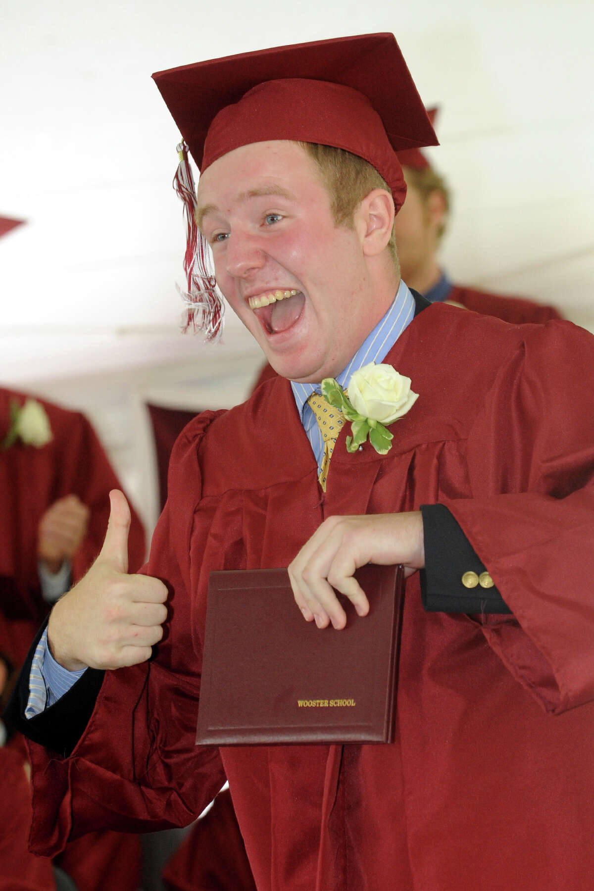 Richard Randolph, of Danbury, gives the thumbs up after receiving his diploma during commencement for the Wooster School Class of 2013, in Danbury, Conn., June 14th, 2013