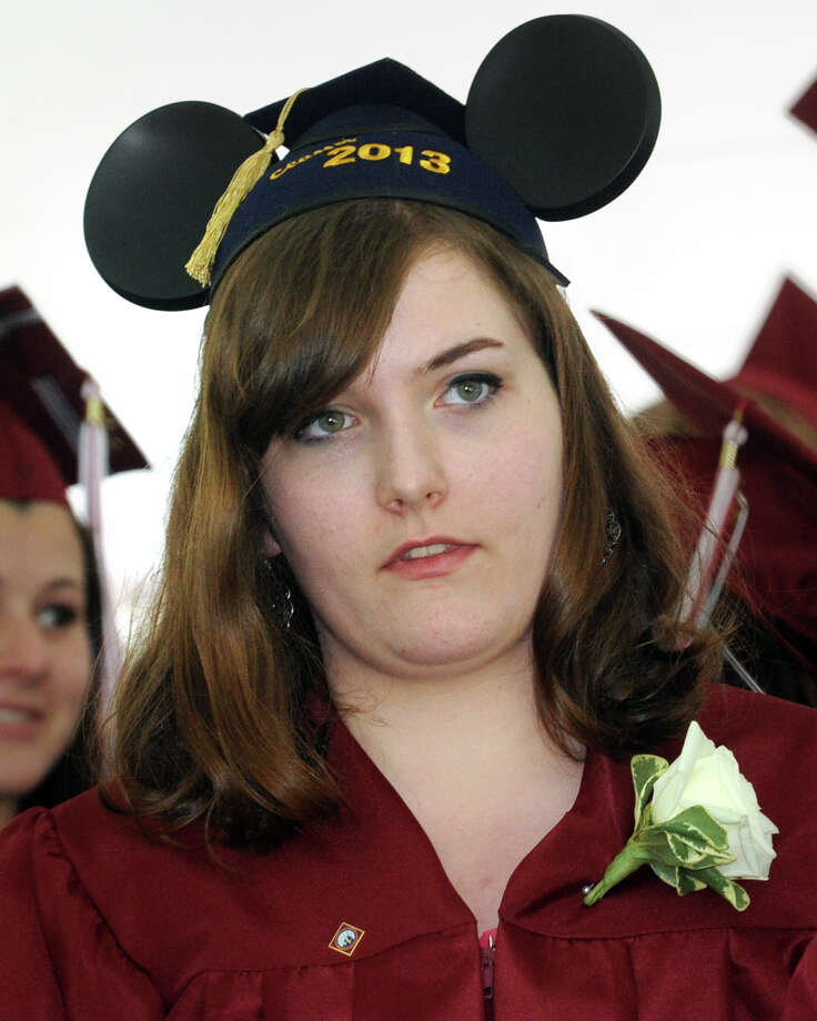 Madison Becker, of Ridgefield, wear mouse ears during commencement for the Wooster School Class of 2013, in Danbury, Conn., June 14th, 2013 Photo: Ned Gerard / Connecticut Post