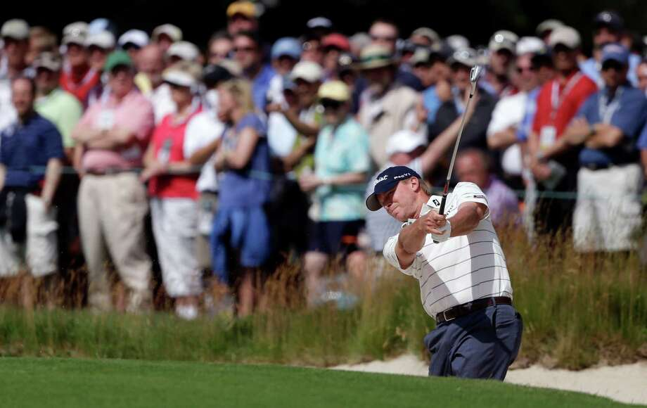 Steve Stricker hits out of a bunker on the first hole during the second round of the U.S. Open golf tournament at Merion Golf Club, Friday, June 14, 2013, in Ardmore, Pa. (AP Photo/Darron Cummings) Photo: Darron Cummings, Associated Press / AP