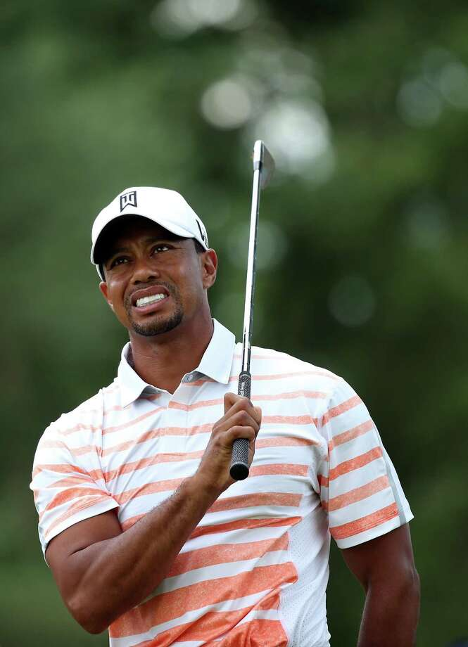 ARDMORE, PA - JUNE 14:  Tiger Woods of the United States grimaces after hitting his second shot on the eighth hole during Round Two of the 113th U.S. Open at Merion Golf Club on June 14, 2013 in Ardmore, Pennsylvania. Photo: Andrew Redington, Getty Images / 2013 Getty Images