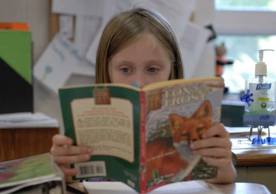 Studies show that reading old-fashioned print books has significant advantages over e-reading, especially for children. Photo: Associated Press