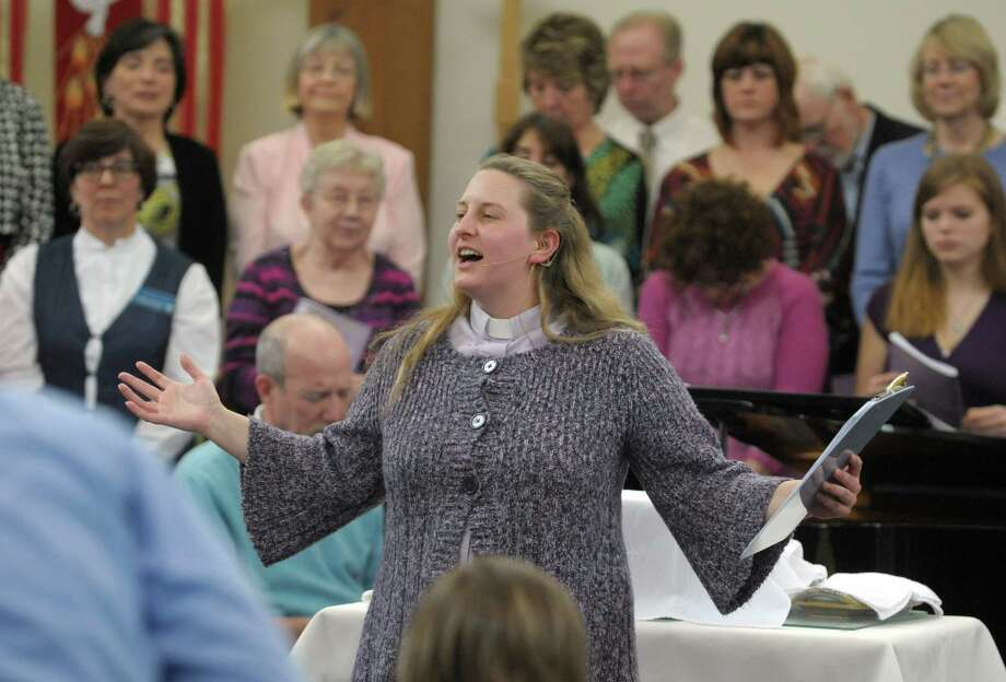 Associate Pastor Amber Waugaman closes   the Palm Sunday cantata service at the Prince of Peace Lutheran Church on Sunday, March 24, 2013 in Clifton Park, NY.  Senior Pastor Jeff Silvernail said that the service allows them to tell the story of the final week of Jesus's life through song, narration and using items of symbolism.  This is the fourth year the church held a cantata for Palm Sunday.  The church will celebrate Easter Sunday with two traditional services at 8am and 11am and a contemporary service at 9:30am.  (Paul Buckowski / Times Union) Photo: Paul Buckowski / 00021675A