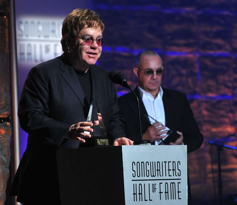 NEW YORK, NY - JUNE 13:  Elton John and Bernie Taupin speak at the Songwriters Hall of Fame 44th Annual Induction and Awards Dinner at the New York Marriott Marquis on June 13, 2013 in New York City.  (Photo by Larry Busacca/Getty Images for Songwriters Hall Of Fame)