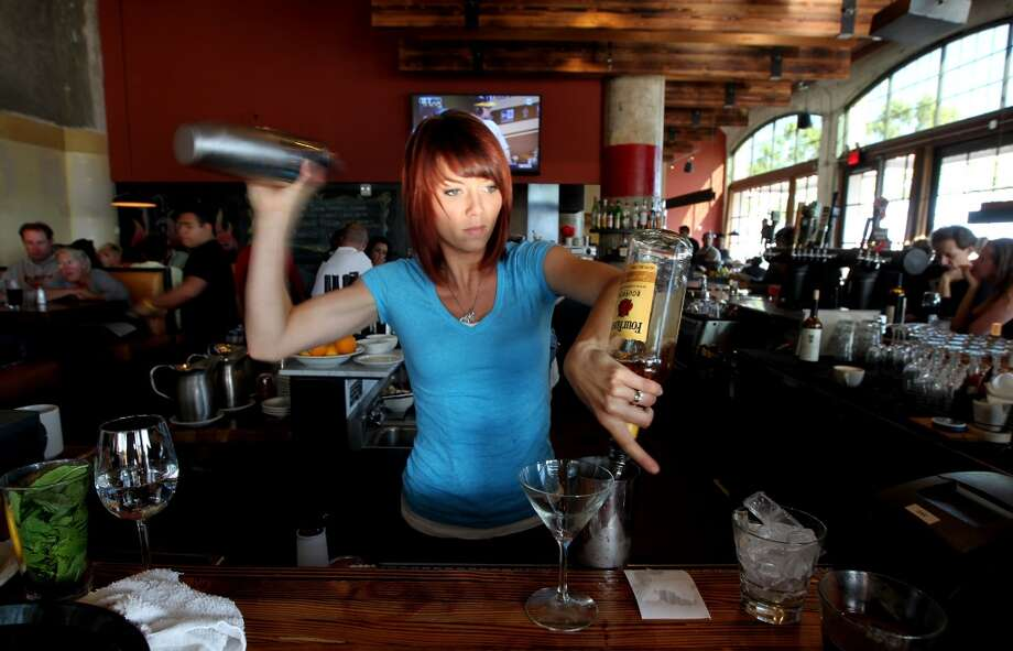 Bartender Ashley Myers prepares cocktails at the Forge.
