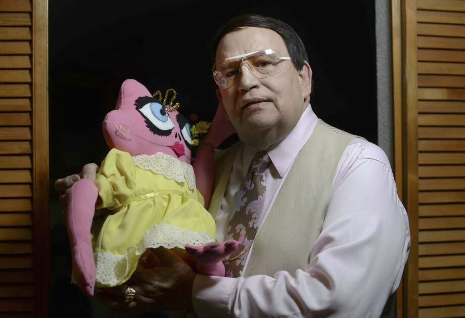 Author Freddrick Campioni Garcia, aka Raynn Walker Jr., holds a Toadina doll. Photo: Billy Calzada / San Antonio Express-News