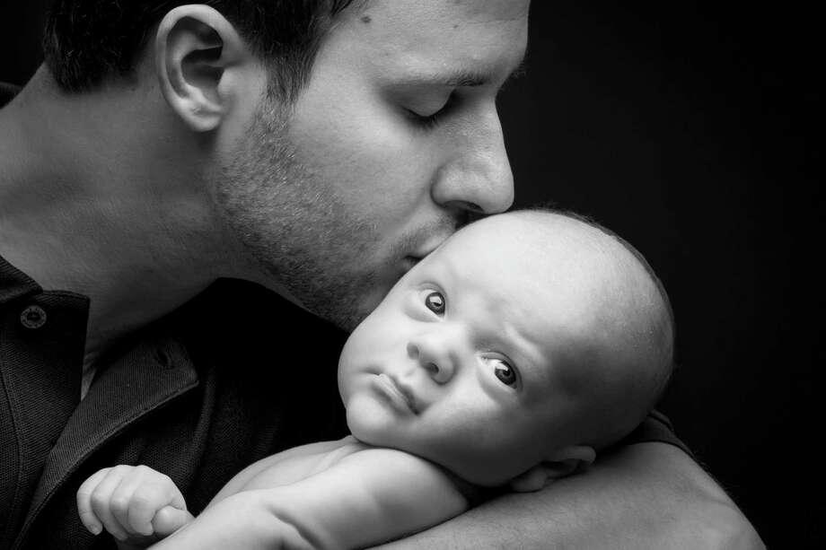 Jeffrey Wisnoski holds his one-month-old son Owen. Photo: Michael Paulsen, Staff / © 2013 Houston Chronicle