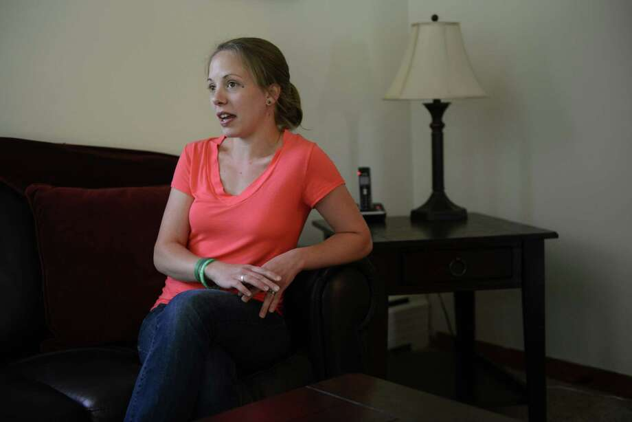 Cristina Hassinger, daughter of slain Sandy Hook Elementary School Principal Dawn Hochsprung, speaks during a News-Times interview in her Oakville, Conn. home on Friday, June 14, 2013.  Hassinger was given a tour of Sandy Hook Elementary Friday, six months after the shooting that killed 26 students and educators. Photo: Tyler Sizemore / The News-Times
