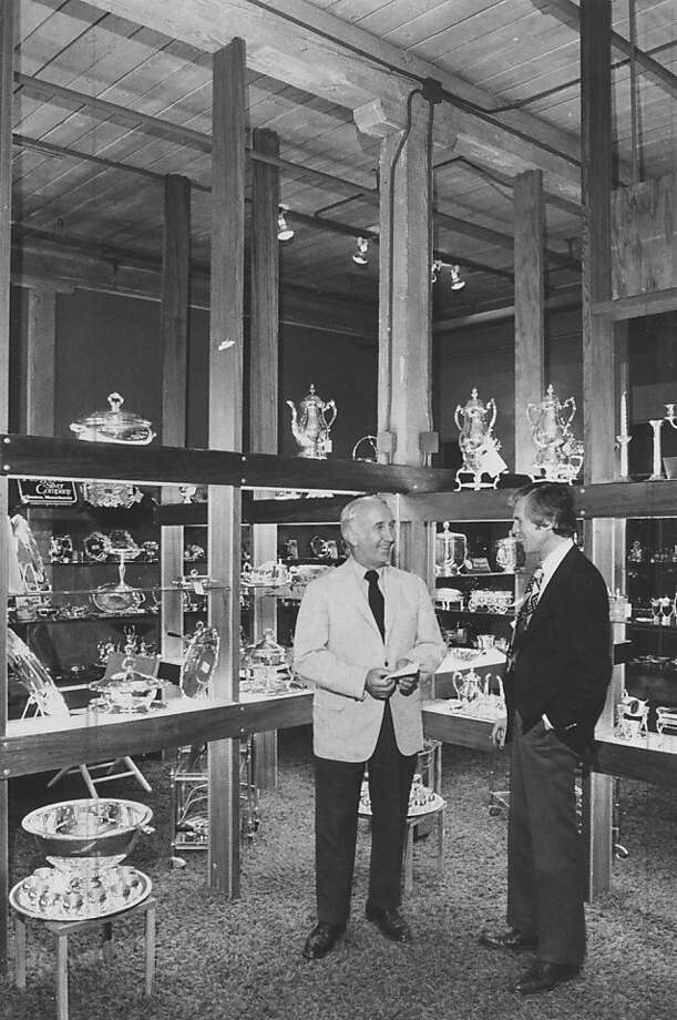 Henry Adams (left) in 1972 with Robert Zinkhon, at a showroom featuring a silverware manufacturer's collection. Photo: Larry Tiscornia, Chronicle Staff