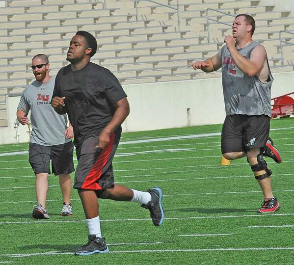 Lamar head strength & conditioning coach Joshua Miller, left with glasses, was promoted to that posi