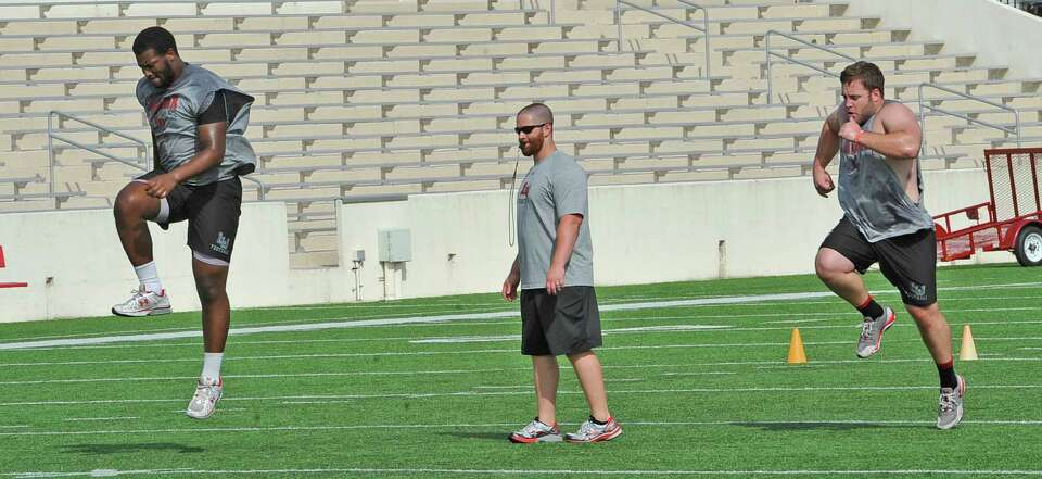 Lamar head strength & conditioning coach Joshua Miller, center with glasses, was promoted to that po