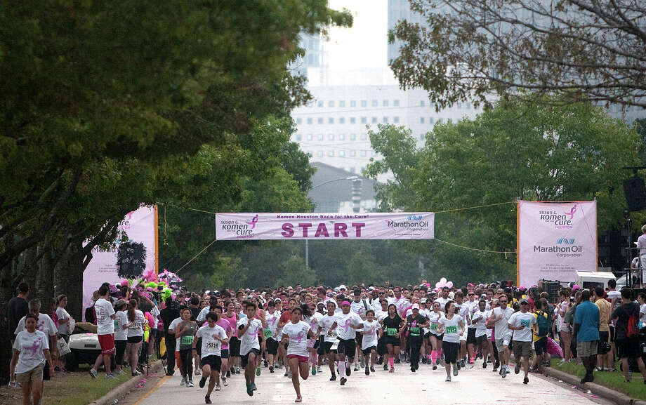 Runners compete in the 2012 Komen Race for the Cure in Houston. The race raises awareness of breast cancer and celebrates cancer survivors. Photo: Cody Duty, Staff / © 2012 Houston Chronicle