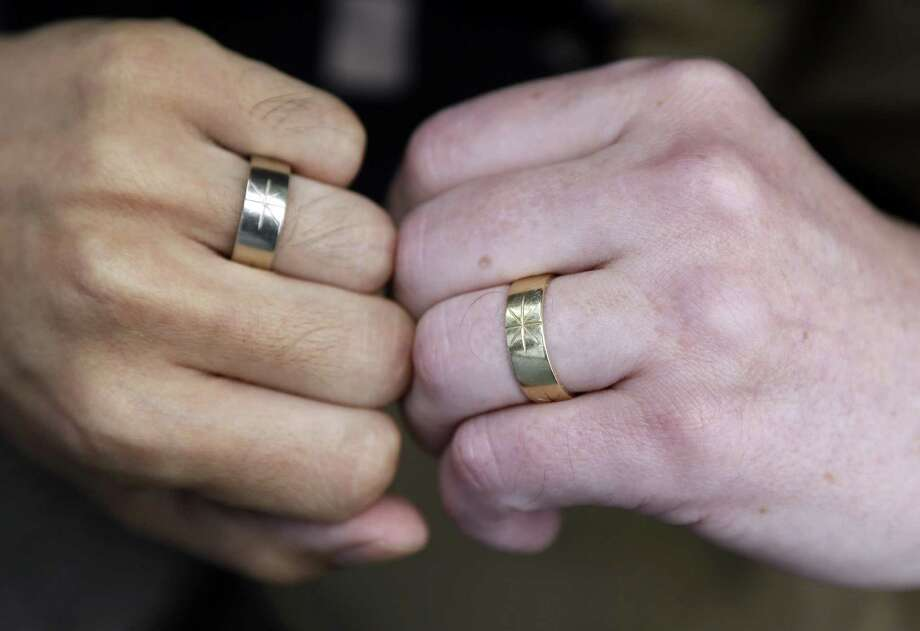 Thom Watson (right) and Jeff Tabaco show the rings they exchanged at their 2009 California wedding ceremony. Photo: Marcio Jose Sanchez / Associated Press