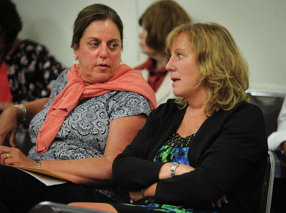 Scheduled to be laid off from their jobs, Parent Center facilitator Dolores Mason, left, and coordinator Lisa Pavlich attend the Board of Education meeting at the Aquaculture School in Bridgeport, Conn. on Monday, June 10, 2013. Photo: Brian A. Pounds / Connecticut Post