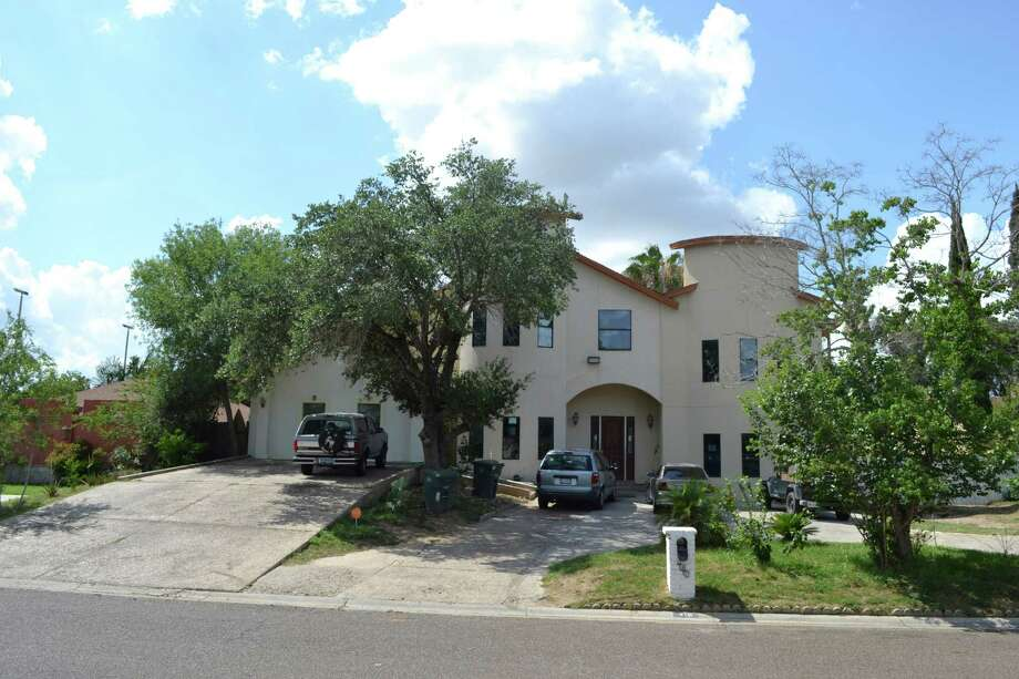 Police arrested Elsa Cuellar Alvarado, 55, and Miguel Alvarado, 63, at this house, seen in a Wednesday June 12, 2013 photo,in a neighborhood on Laredo's wealthy north side and charged them with nine counts of tampering with government documents. Neighbors said the family stood out because of they kept livestock at the house and there were so many children living there. State authorities have removed 10 children from the house. Photo: Jason Buch, San Antonio Express-News / © 2013 San Antonio Express-News