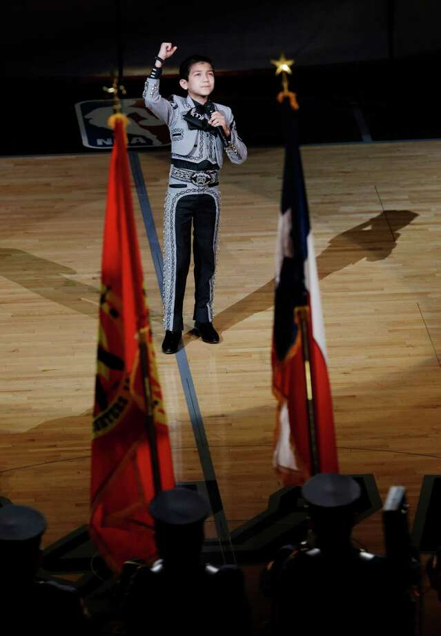 Sebastien de la Cruz received racist taunts after singing the national anthem in a mariachi costume. Photo: David J. Phillip, STF / AP