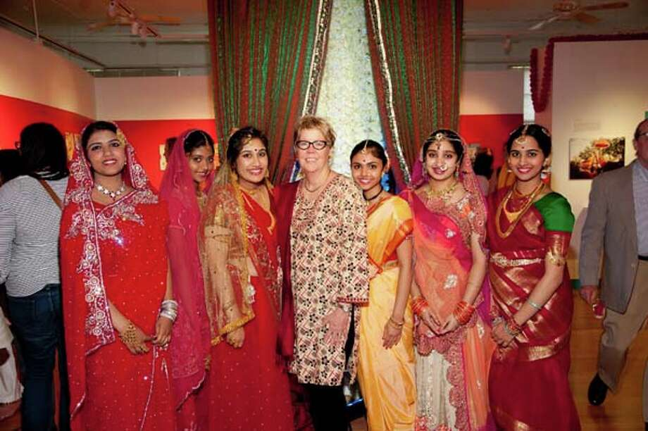 Pat Jasper, center, and models show wedding attire for a traditional Indian wedding.