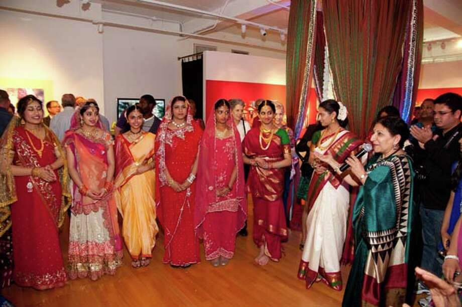 Rathna Kumar  presents the brides  in an informal fashion show at the opening reception of the Houston Arts Alliance Folklife + Traditional Arts Program s Anointed and Adorned: Indian Weddings in Houston exhibition. Photo: Alexander S Fine Portrait Design / Alexander Rogers