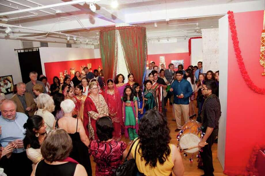 Crowd shot at the opening reception of the Houston Arts Alliance Folklife + Traditional Arts Program s Anointed and Adorned: Indian Weddings in Houston exhibition. Photo: Alexander S Fine Portrait Design / Alexander Rogers