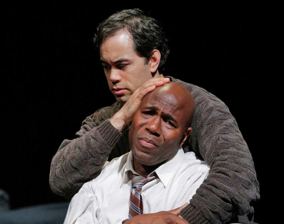 "This undated image released by the Opera Theatre of Saint Louis shows Arthur Woodley as Emile Griffith, foreground, and Brian Arreola as Luis Rodrigo Griffith in Opera Theatre of Saint Louis' 2013 world premiere production of ""Champion,"" by Jazz composer Terence Blanchard. Blanchard's ""Champion"" _ with a libretto by Pulitzer Prize-winning playwright Michael Cristofer _ is based on the life of former world welterweight and middleweight champion Emile Griffith. Its world premiere comes at the Opera Theatre of St. Louis on Saturday, June 15. (AP Photo/Opera Theatre of Saint Louis, Ken Howard) Photo: Ken_Howard, HOEP / Opera Theatre of Saint Louis"