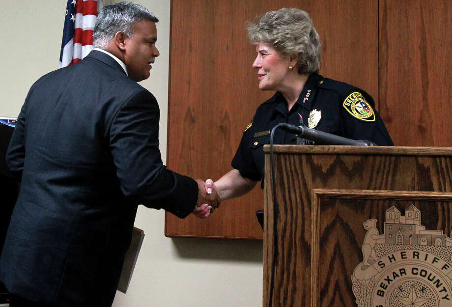 Raul S. Banasco (left) shakes hands with Bexar County Sheriff Susan Pamerleau (right) Friday June 14, 2013. Banasco has been named the new Bexar County Jail Administrator. He was presented to the media Friday June 14, 2013 at a press conference at the Bexar County jail by Bexar County Sheriff Susan Pamerleau. Banasco has 27 years of experience and has worked in New York and Florida. Photo: JOHN DAVENPORT, SAN ANTONIO EXPRESS-NEWS / ©San Antonio Express-News/Photo may be sold to the public